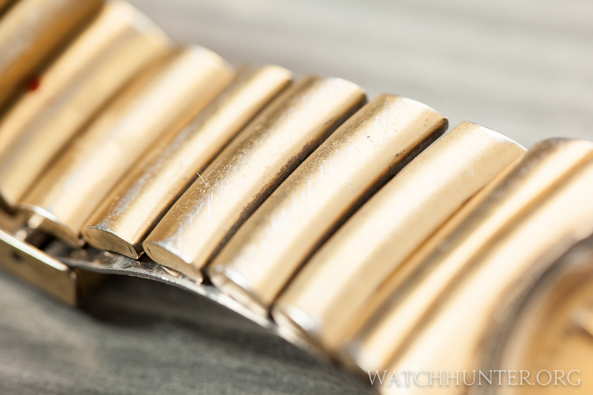 The electroplating was worn off. This watch got used