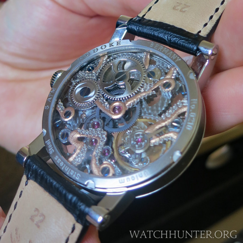The Kudoktopus watch has an octopus with tentacles on the front and back of the movement