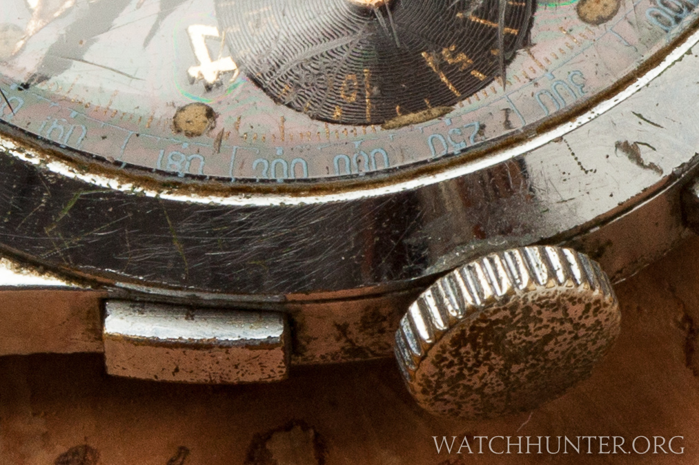 A closeup of the pitted and scratched surfaces. This is what time can do to metal.