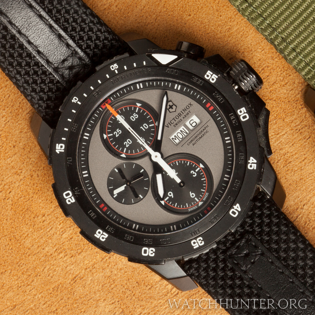 This model has red and orange accents against black and gray. It is military chic.