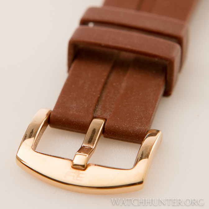 A matching bronze-like finish on the buckle