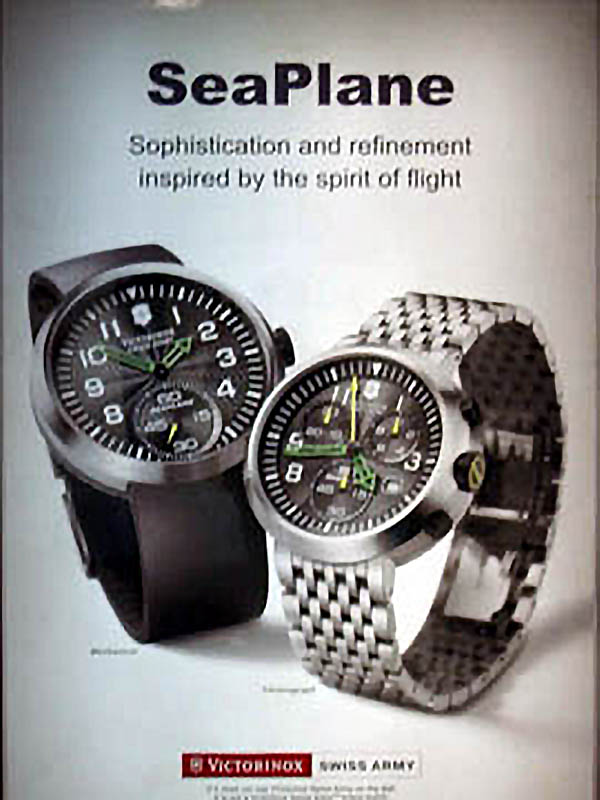 An old and blurry advertisement for a Swiss Army SeaPlane XL and SeaPlane Chronograph (with mysterious hands & bracelet)