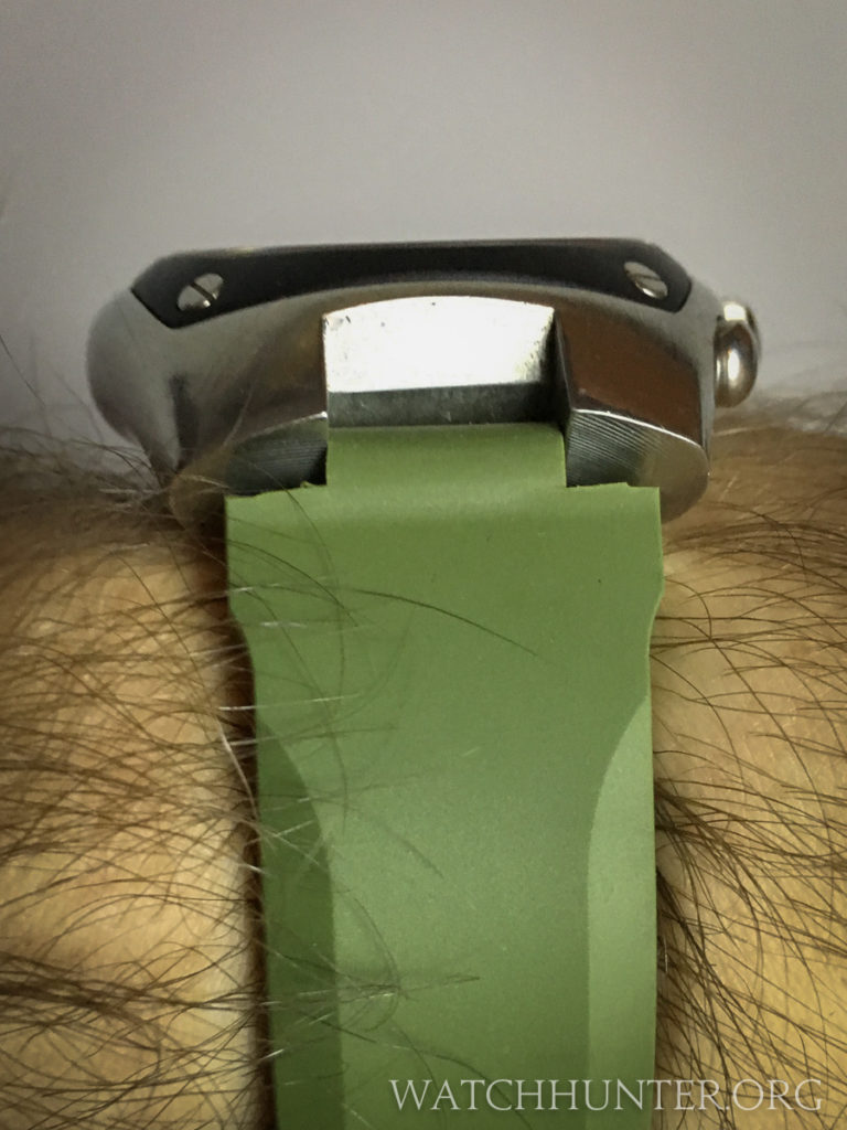 This stiff strap makes my watch float above my wrist. Not comfortable at all.