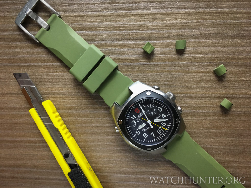 The results of a Victorinox Swiss Army Hunter Mach 2 on a customized Tsovet green rubber diver's watch band.