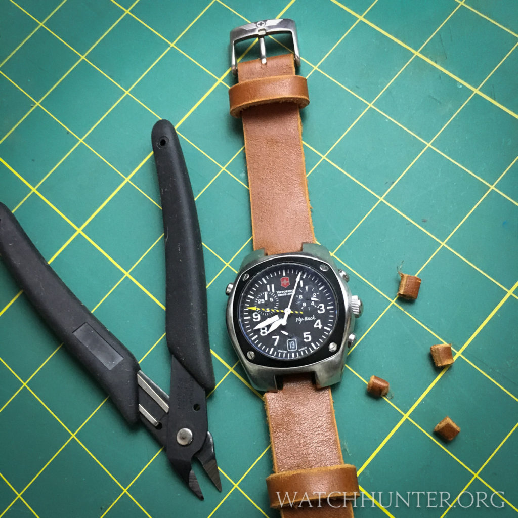 Small snips cleanly cut the leather watch band for the Victorinox Swiss Army Hunter Mach 2 Chronograph.