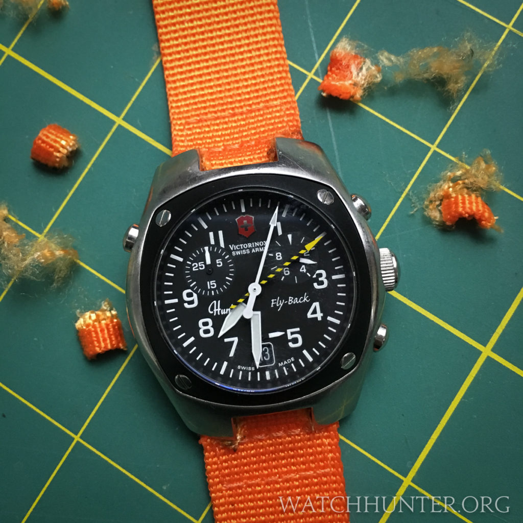A Victorinox Swiss Army Hunter Mach 2 on an orange nylon strap. It only cost $4.