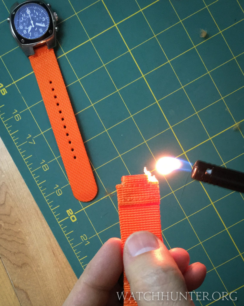 Flames fix the edges on my frayed nylon watch band.