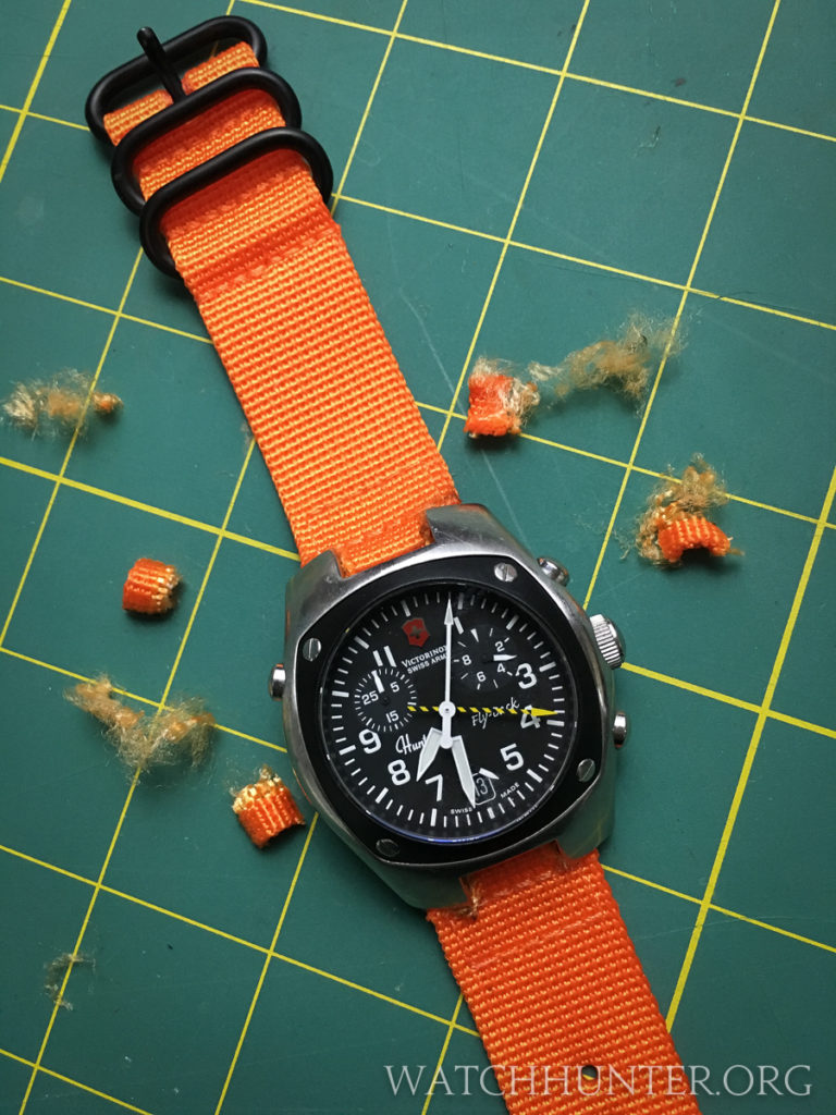 The watch band's PVD hardware ties in with the Hunter Mach 2's black dial and bezel.