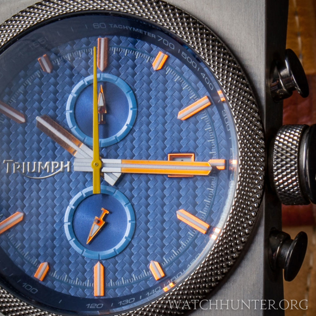 Real carbon fiber weave, applied copper markers and tachymeter scale on the Triumph Scrambler Dial.
