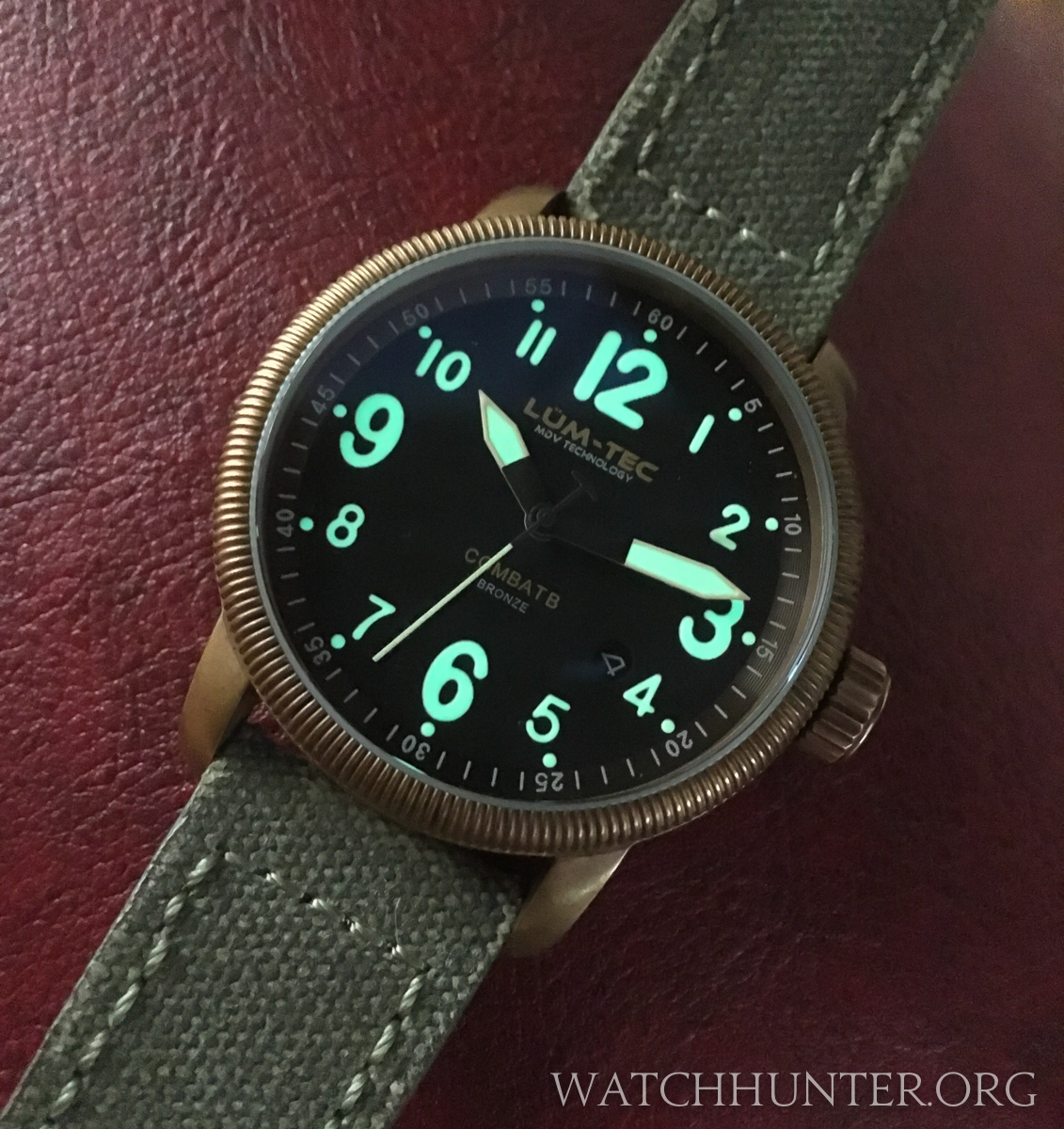 A Lum-Tec Combat B18 Bronze in a low light setting shows how strong the lume glows.
