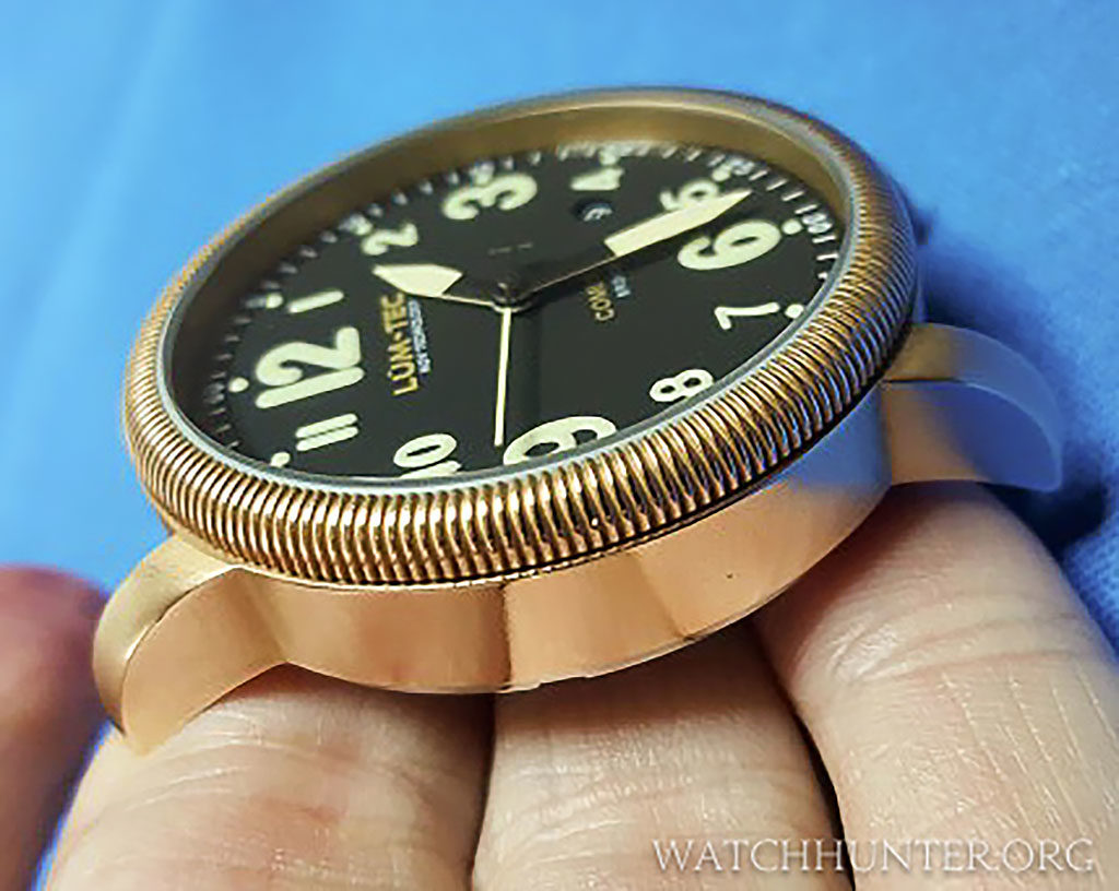 I purchased the watch devoid of patina. The bronze is more golden and brassy looking.