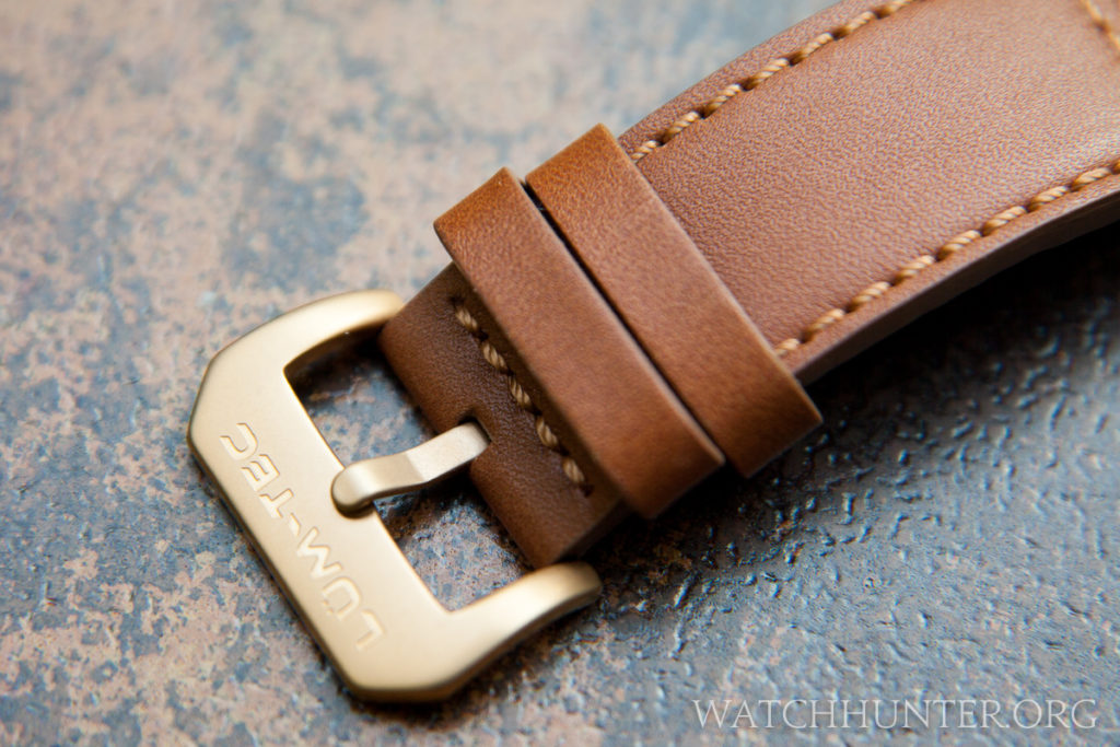 The leather watch band with bronzish buckle is excellent.
