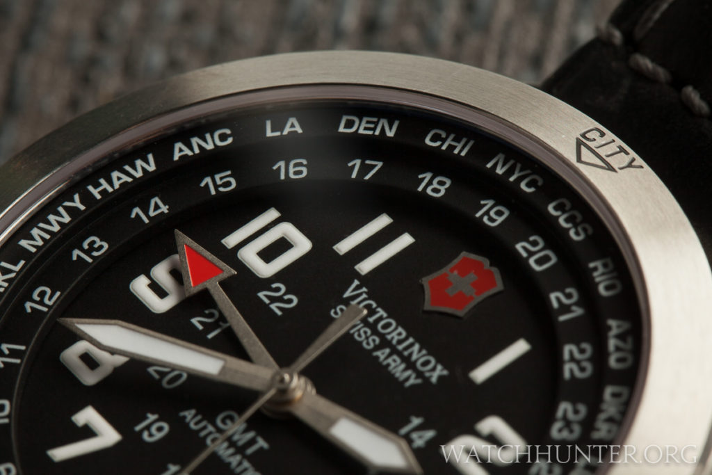 The 24 hour military scale and well known city abbreviations on inner bezel