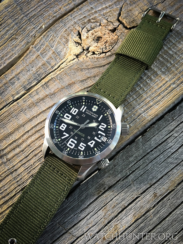 OD green picks up the greenish tint of the dial text and lume.