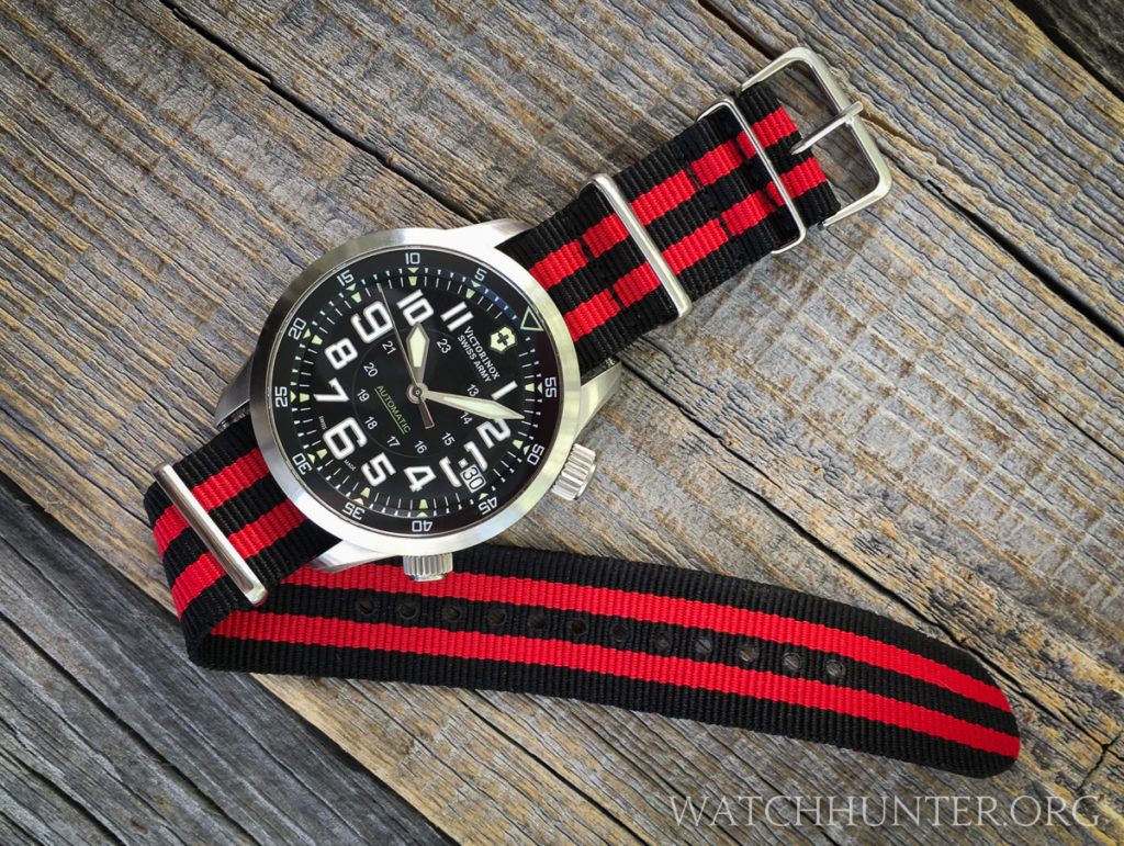 A Victorinox Swiss Army Airboss Mach 7 on a red & black striped 22 mm NATO